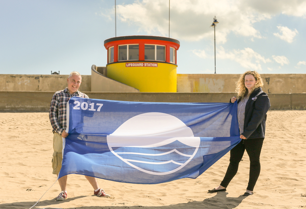 This year's Blue Flag is delivered to Bundoran Tourism Officer by Beckey-Finn Britton, An Taisce Coastal Programmes DevelopmentOfficer for Donegal - Pic Conor Conlon CMP Productions