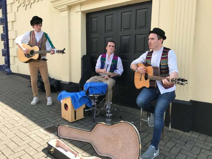 Tom, Dougie and Harry of Old Hannah perform on Main Street