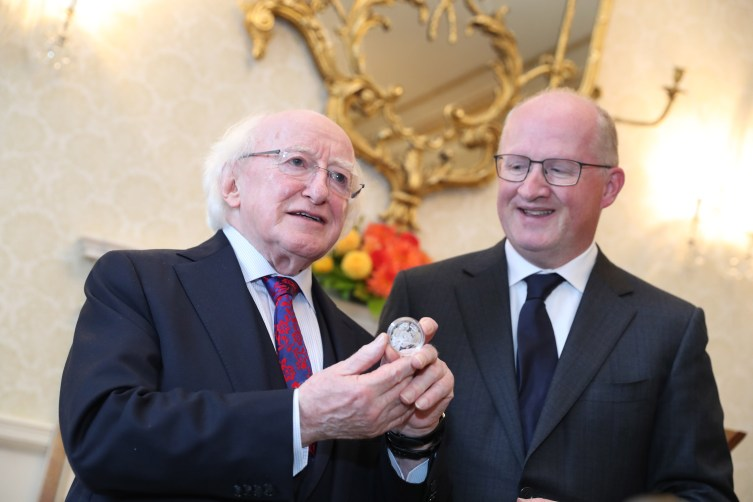 President receives a commemorative silver 'Rory Gallagher' coin commissioned by Central Bank in Aras An Uachtarain todayPresident Higgins hosted an event to mark the unveiling of a new commemorative coin in honour of the legendary Irish guitarist Rory Gallagher.Pic shows: Central Bank Governor Philip R. Lane as he presented the commemorative silver coin to President Michael D. Higgins.Pic Maxwell's/Áras An Uachtaráin 17-9-18