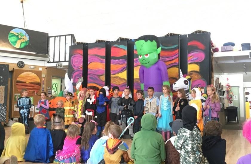 Performing Halloween songs.