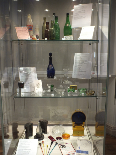Glass display case with glassware inside