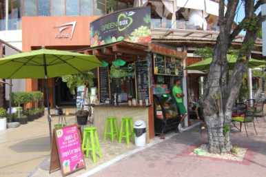 Right in front of Plaza Luna. Makes fresh juices for your health