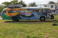 The RV lifestyle in Puerto Morales. Looks like an old school bus conversion in the a psychedelic style of the 60's