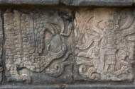 This is a carving on the wall of the jaguars and serpents platform depicting both eagles and jaguars clutching a human heart indicating that human sacrifices may have been made here