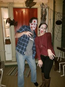 image of two people dressed as zombies