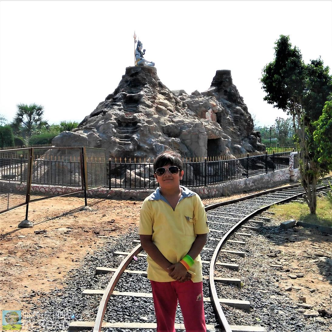 Toy Train track with Shiva statue in background at hill garden bhuj