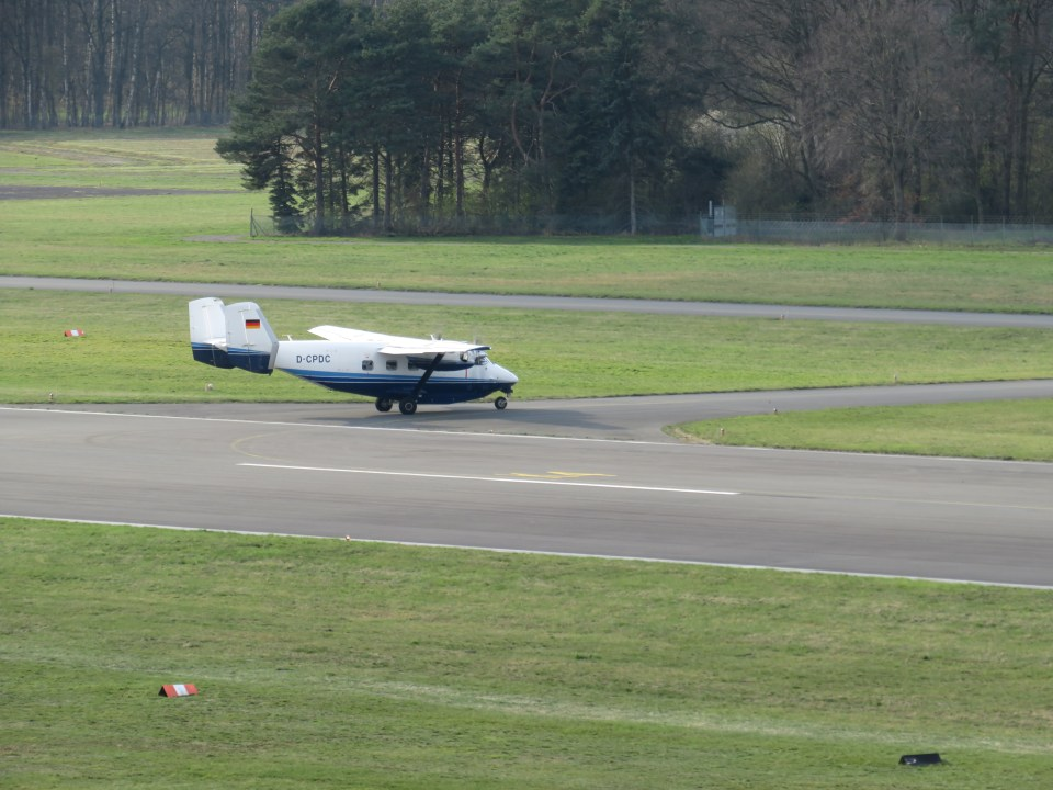 Parajumper drop plane D-CPDC (M28) approaching runway 08 at Celle-Wietzenbruch for landing.