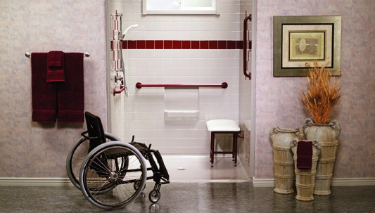 Roll-in shower with grab bars and extra wide access. Accessibility in Belgian hotels.