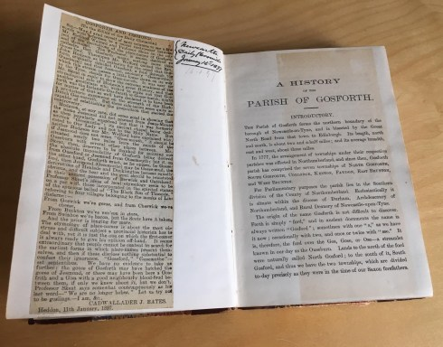 Insert of A History of the Parish of Gosforth showinf newspaper cutting.