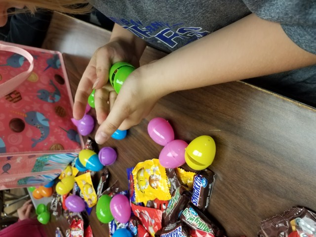 Filling Easter eggs for a community service project