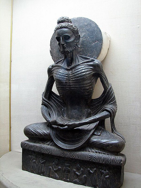 """Fasting Siddhartha"", recovered from Sikri, dating to the 1st - 3rd century CE, Lahore Museum. This remarkable image of Siddhartha Gautama (the future Buddha) is from the ascetic period of his life, which lasted six years. Eventually, Siddhartha realized that the path of fanatical asceticism was as unproductive as his previous life of incessant luxury. He then embraced the Middle Way, between extreme luxury and extreme austerity. In this sculpture, the realism in the treatment of the Buddha's emaciated body was characteristic of Gandharan interests, but not commonly employed in the rest of the Indian subcontinent."