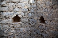 A monk's cell at Jaulian monastery, Taxila, dating to the 5th century CE. The niches were used to keep personal articles and oil lamps.