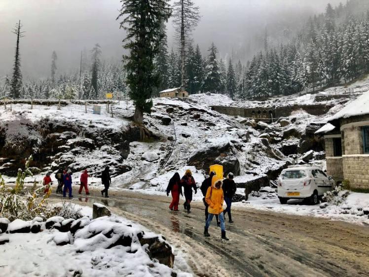 Tourists enjoy snow at Kothi