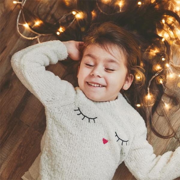 Smiling girl enjoying the holiday season