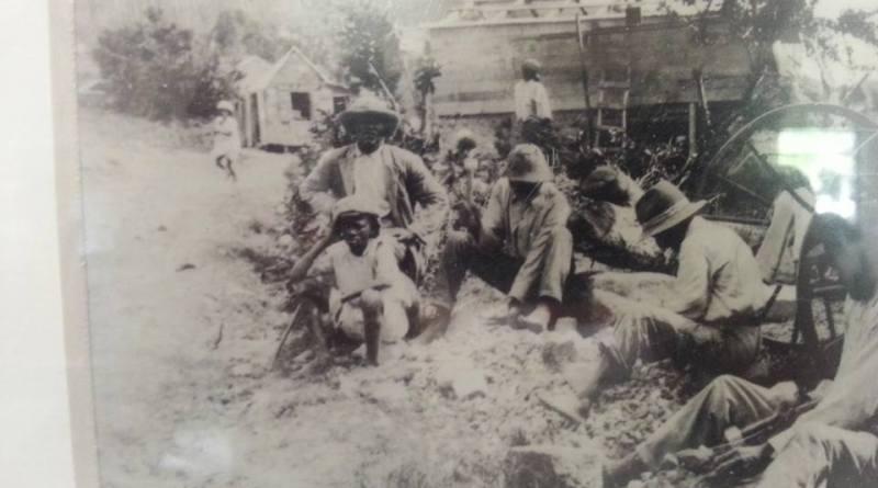 Men break rocks for use in the rebuilding of the Methodist Church in the 1920s.