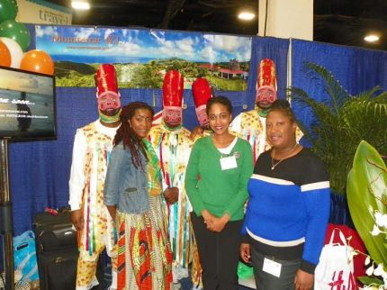 "From Left: Members of the Boston-based Diaspora, Montserrat Aspirers dressed as masquerade dancers, Jadine ""De Soca Diva"" Greenway, CAMC Director of Client Development, Jennifer Johnson and Montserrat Tourism Division's Cherise Aymer, pictured at the Montserrat booth, during The Boston Globe Travel Show, 2016"