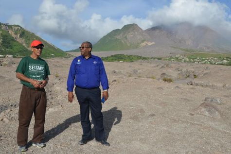 Dr Richard Robertson (left) and Professor Dale Webber inspect the buried and abandoned city of Plymouth at the foot of the Soufrière Hills Volcano, Montserrat. Photo: Roderick Stewart/MVO.