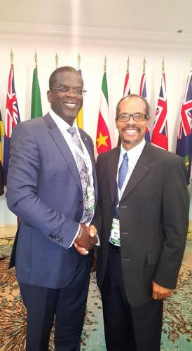 Above Minister Hogan is congratulated by the Executive Director of the Caribbean Regional Fisheries Mechanism (CRFM) Mr Milton Haughton. (CHogan Phto)