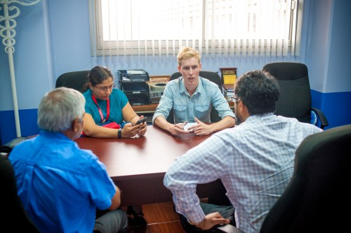 Thomas Langerak, PhD student at Erasmus Medical Centre, Holland, second from right, demonstrates the use of the new Caribbean database for Guillain-Barré syndrome to (L-R) Dr Azad Esack,Consultant, Neurologist, Eric Williams Medical Sciences Centre, Mount Hope (EWMSC); Dr Sherry Sandy, Lecturer in Adult Clinical Medicine at The University of the West Indies, St Augustine (UWI); and Dr Avidesh Panday, Consultant, Neurologist, EWMSC, Mount Hope. The meeting took place at the Adult Medicine Unit, Department of Clinical Medical Sciences, Faculty of Medical Sciences, UWI, September 29, 2016.