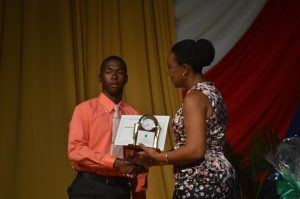 Top CCSLC Student Thousland Galloway receives his award from Hon. Deputy Governor Lindell Simpson.