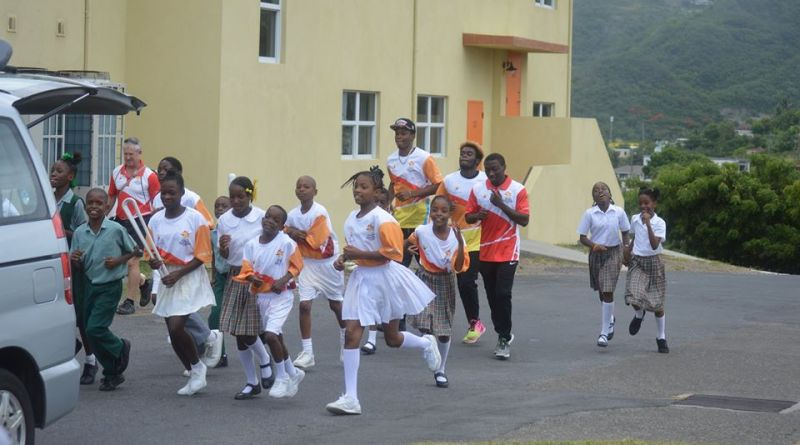 Students from Lighthouse Academy and Brades Primary run around Government Headquarters with the Baton