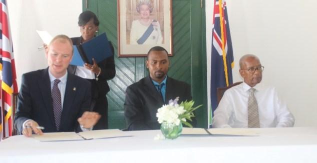 H. E. Governor Augustus Jaspert, Dennison Daley of Rovika Inc. and Hon. Premier Orlando Smith.