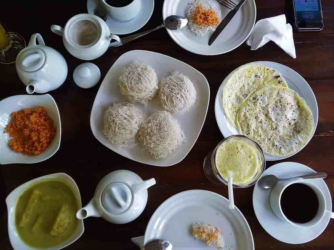 Food in Sri Lanka; String hoppers together with coconut sambol, potato curry, and omelette. Eaten for breakfast.