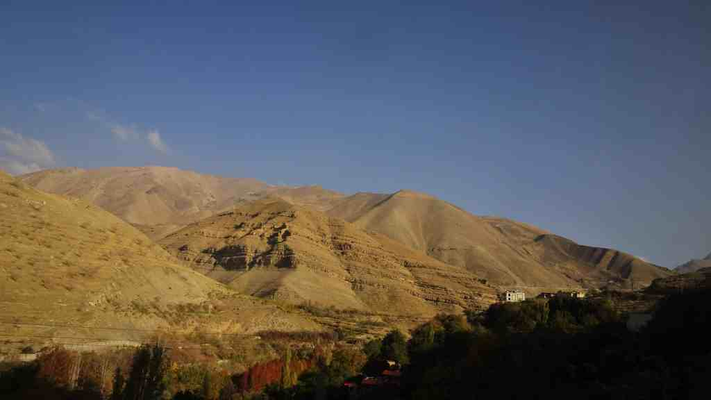 Chalus Road, first views of dry mountains and colorful valleys