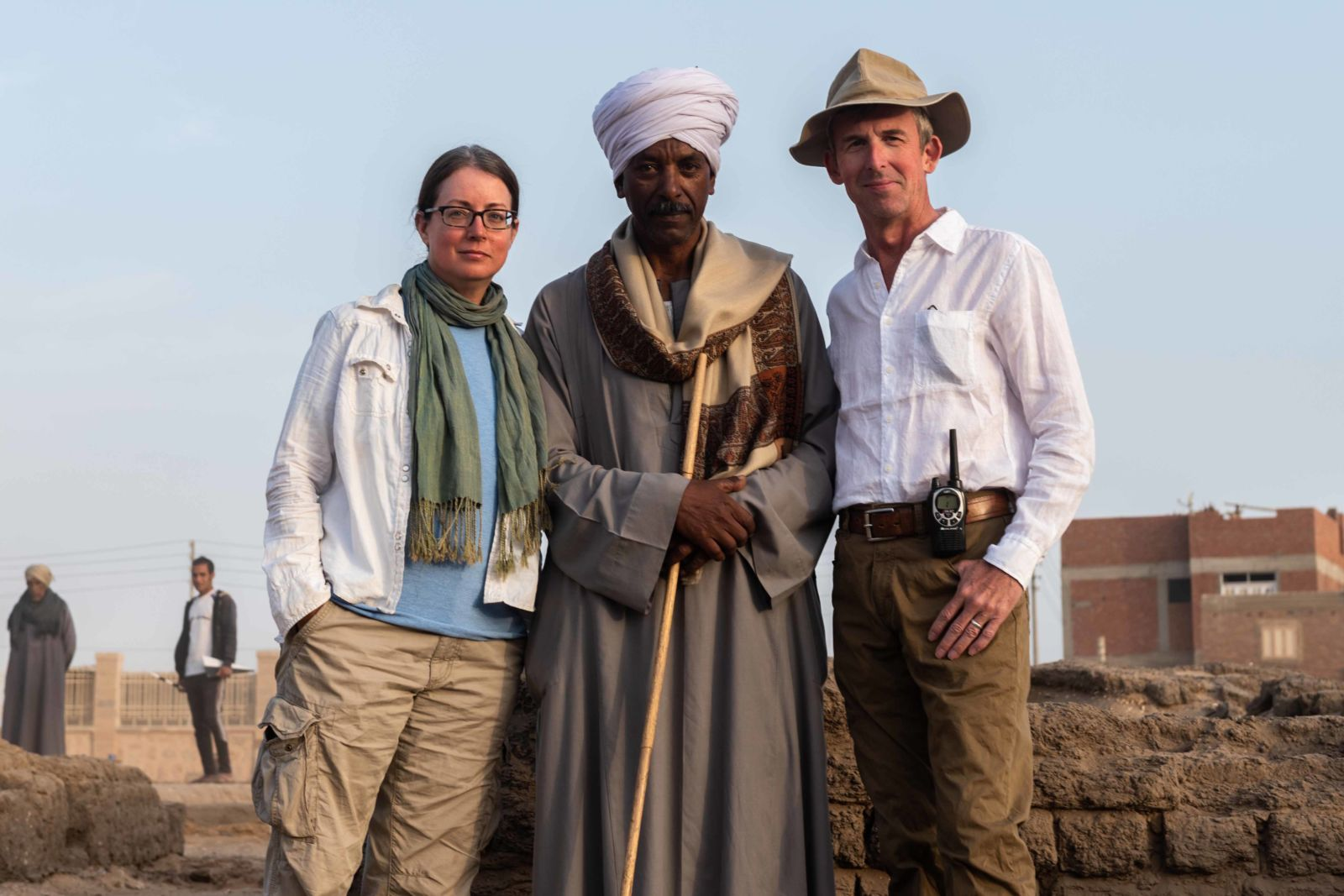 three people standing in Egyptian desert