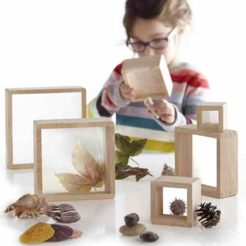 wooden square blocks-magnification blocks-wooden nesting blocks-young girl using the blocks to examine something found in nature