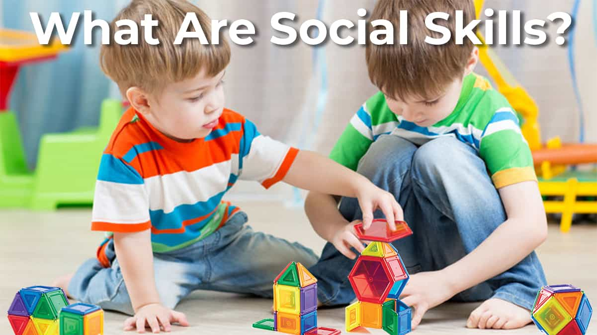 what are social skills-why are social skill important-two young boys playing with magnetic tiles