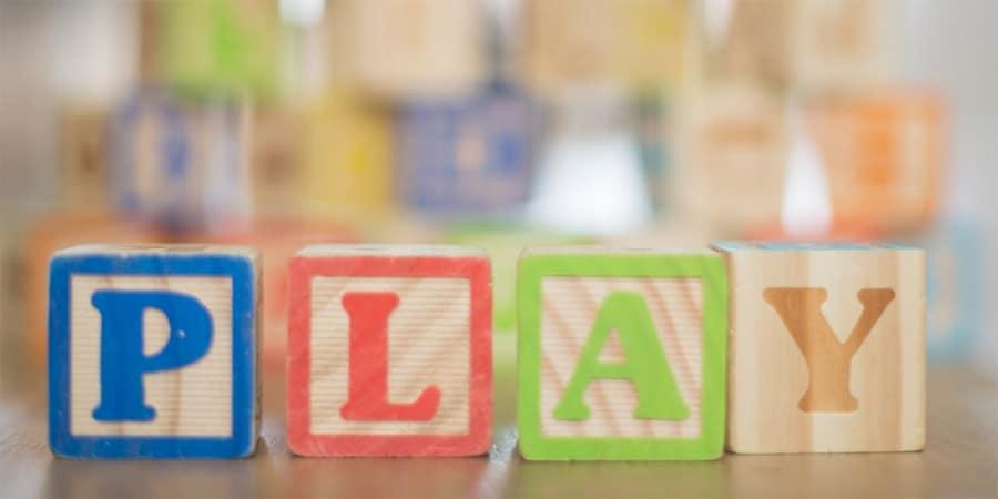language activities for preschoolers-block play-stack of alphabet blocks that spell play