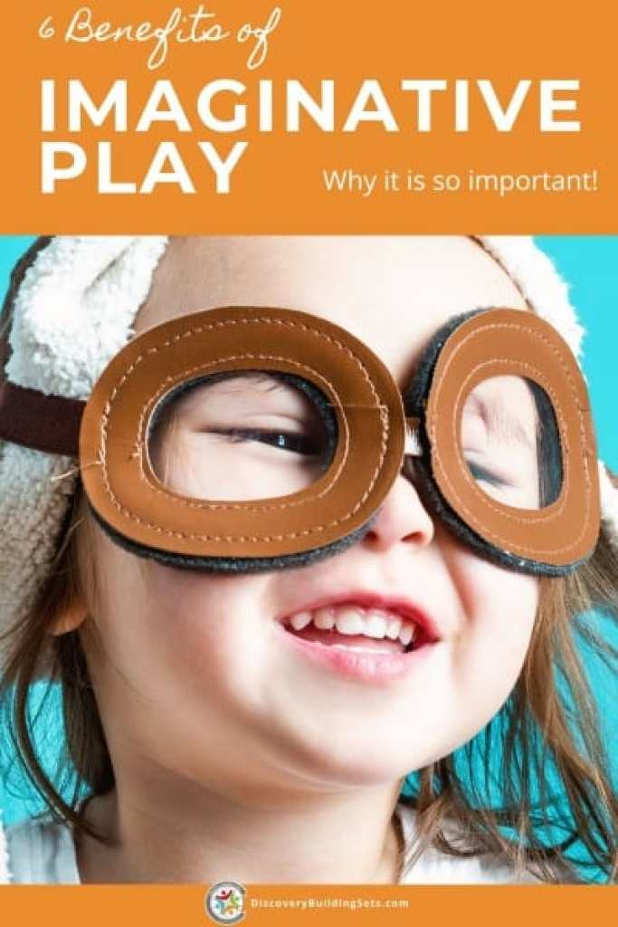 imaginative play-young girl smiling dressed in a pilots hat and goggles