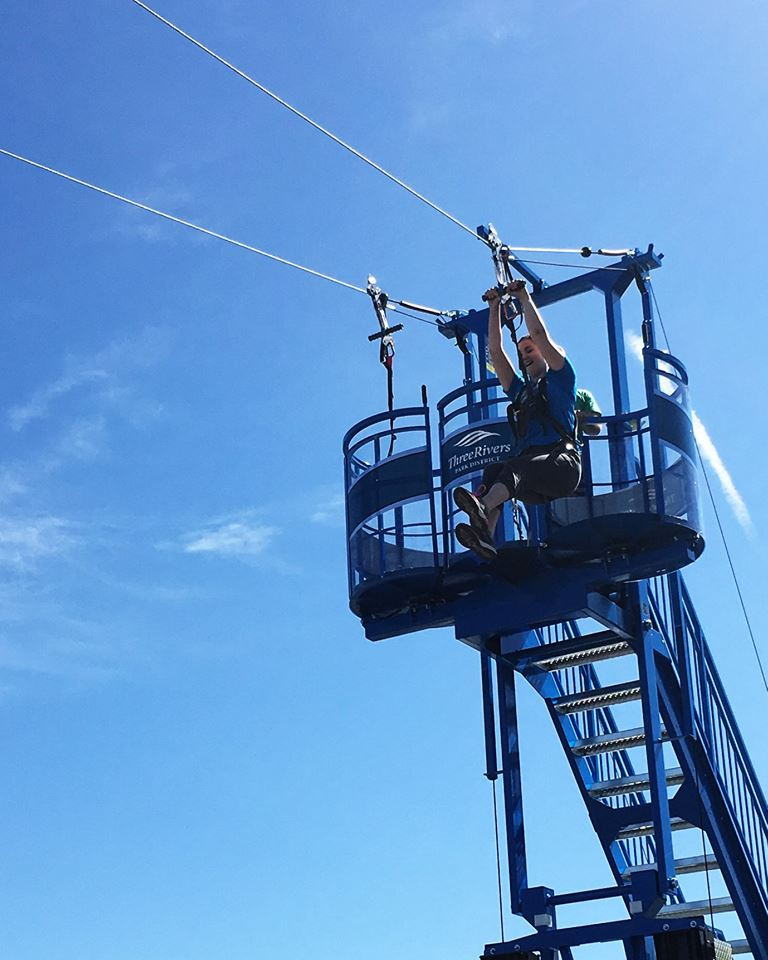 A lady enjoying the Mobile Zip Line