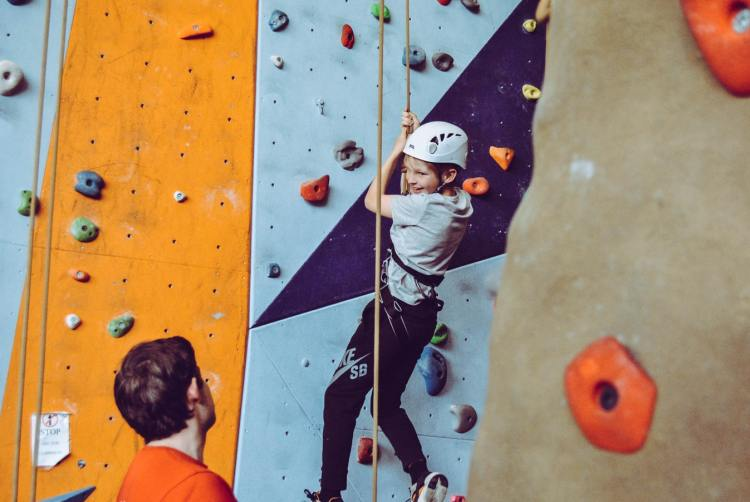 Coming down on an indoor climbing wall