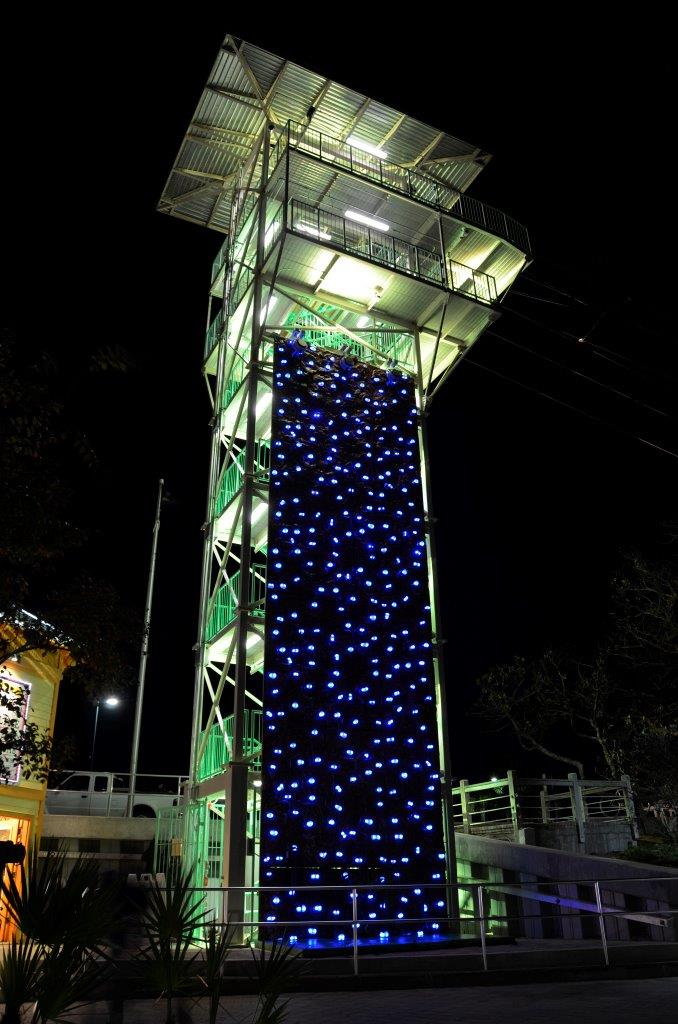 Outdoor climbing tower with led climbing holds at night