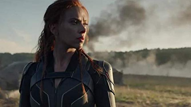 Scarlett Johansson as Natasha Romanoff in a battlefield as seen in Black Widow, a film with a 2021 release date from Marvel and Disney.