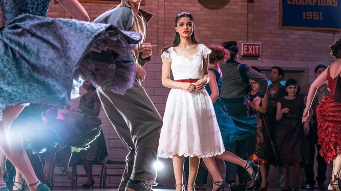 A still of Rachel Zegler as Maria in a room of dancing teenagers as seen in Steven Spielberg's West Side Story, a new adaptation scheduled with a 2021 release date from 20th Century Studios.