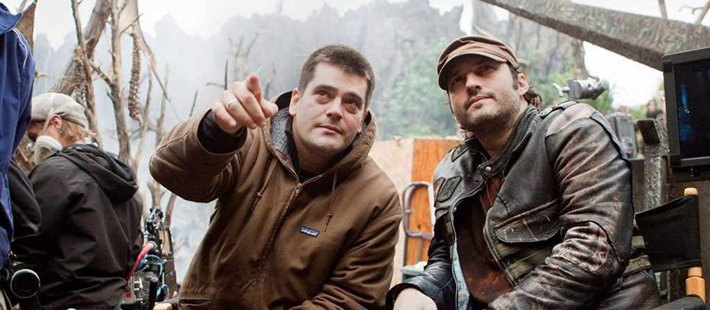 Director Nimród Antal and Producer Robert Rodriguez sitting together on the set of Predators 2010.
