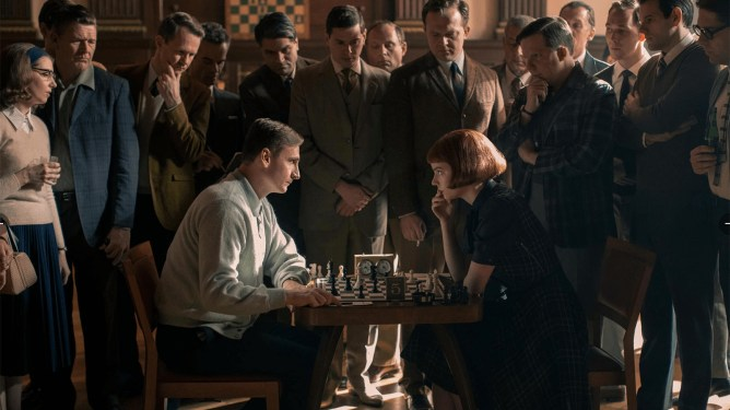 Beth (Anya Taylor-Joy) and one of her opponents face-off while a large group of men watch in 'The Queen's Gambit.'