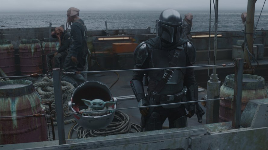 The Mandalorian and Baby Yoda cruise on a fishing boat as seen in Chapter 11 of the show.