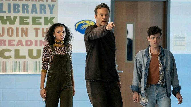 Celeste O'Connor, Vince Vaughn, and Misha Osherovich making their way through a high school hallway as seen in Freaky.