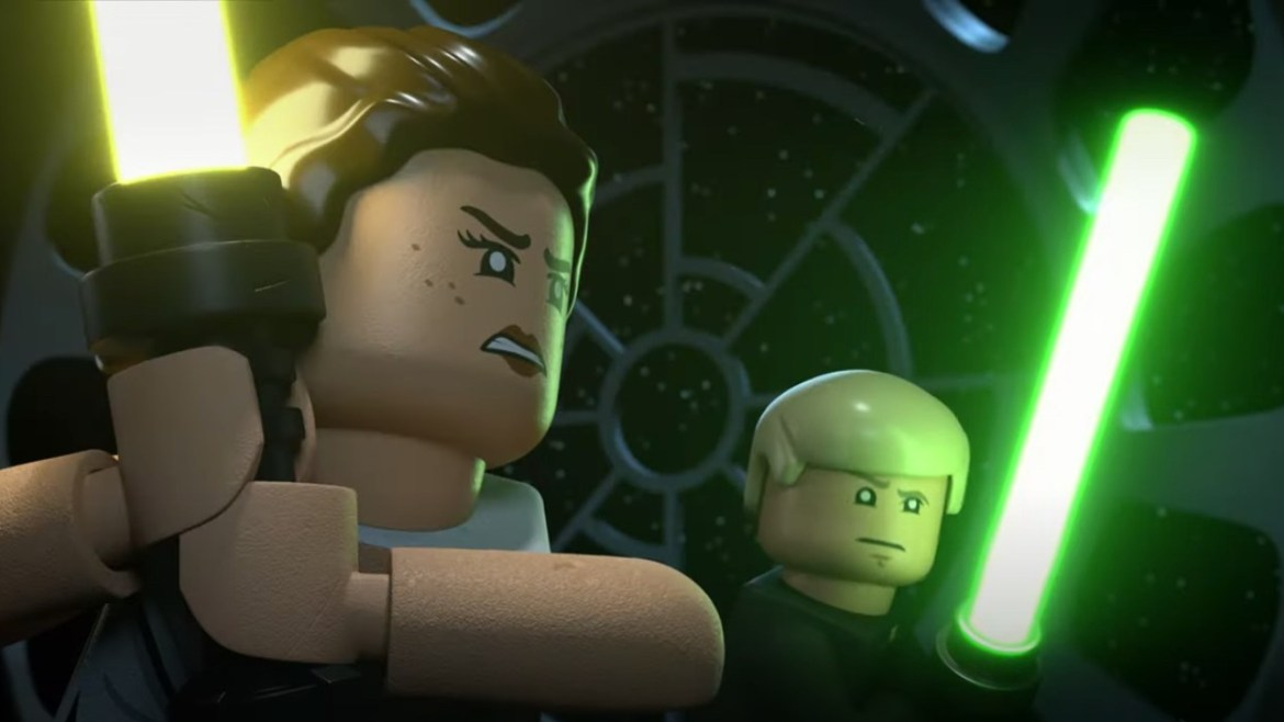 Lego Rey with her new yellow lightsaber stands by Lego Luke Skywalker with his classic green lightsaber as seen in the Lego Star Wars Holiday Special.