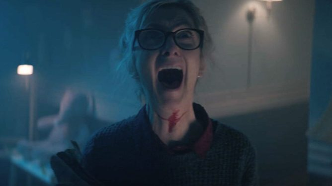 Sheila McCarthy screams for her life with blood across her neck as seen in the Shudder exclusive Anything for Jackson.