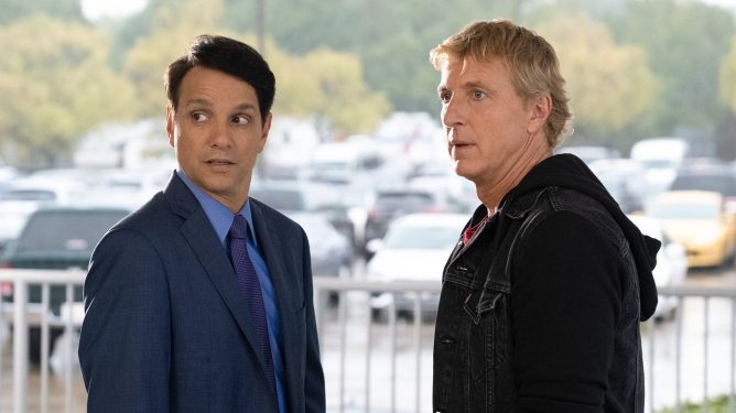 Ralph Macchio and William Zabka having a confrontation as seen in season 3 of Cobra Kai.