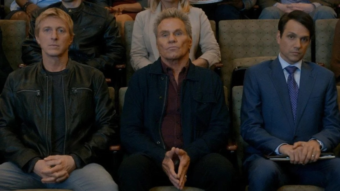William Zabka, Martin Kove, and Ralph Macchio sitting together as seen in season 3 of Cobra Kai.
