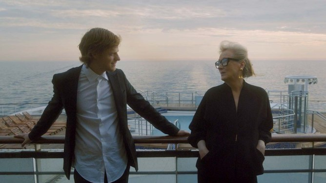 Lucas Hedges and Meryl Streep converse on a boat at sunset as seen in Let Them All Talk.