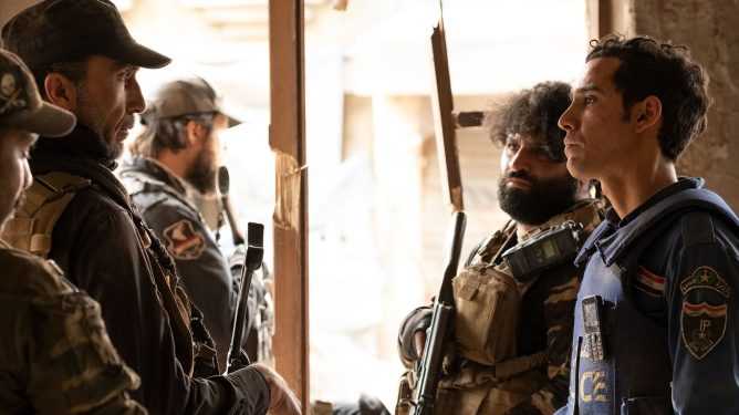 Suhail Aldabbach as Major Jasem and Adam Bessa as Officer Kawa have a tense first meeting as seen in Mosul on Netflix.