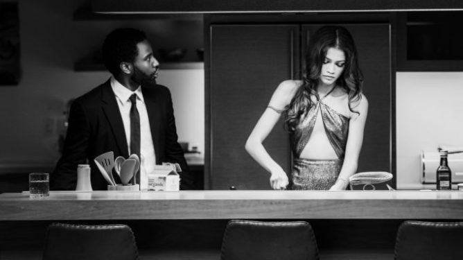 A still of John David Washington and Zendaya wearing fancy clothes in a simple kitchen as seen in Malcolm & Marie, a film scheduled with a 2021 release date from Netflix.