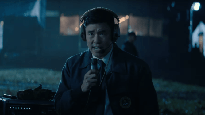Randall Park as agent Jimmy Woo sending a radio signal in Episode 4 of WandaVision.